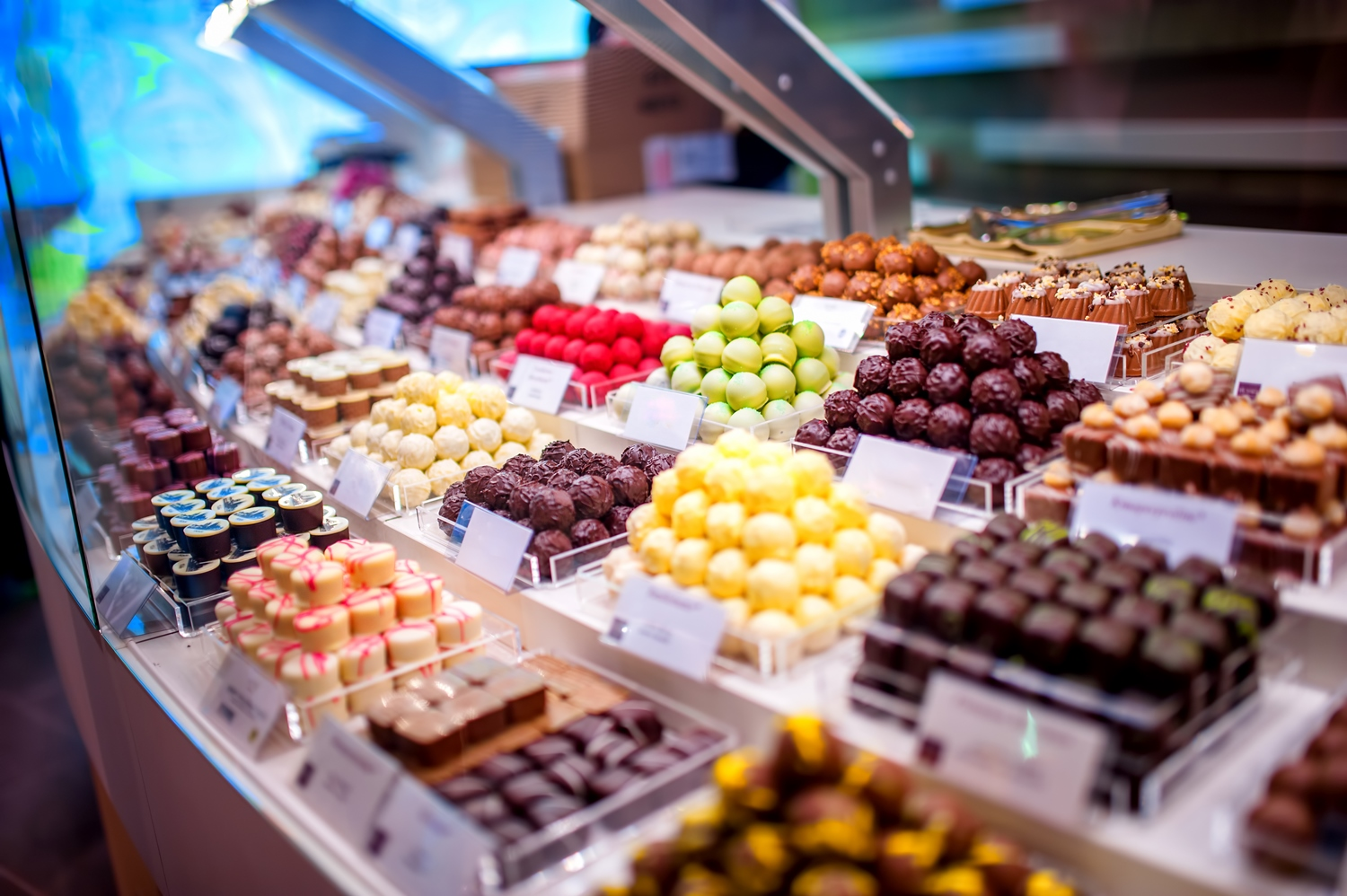 chocolate truffes, candies and sweets store on showcase in facto